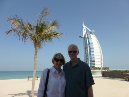 Deb and John walking by Burj al Arab